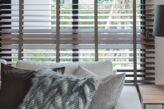 A close up wooden shutters in modern interior room with